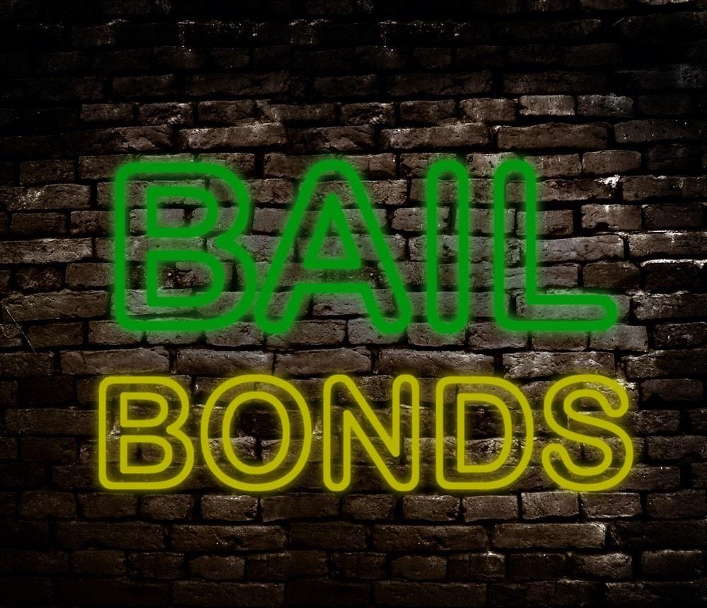 Neon style Bail Bond sign on brick wall